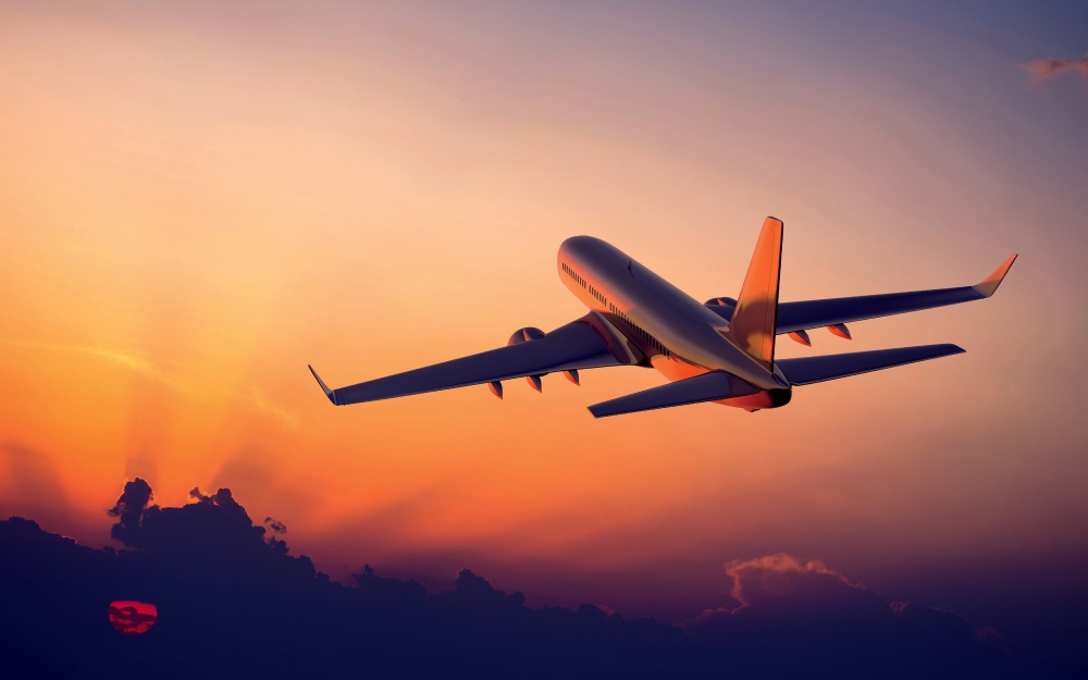 airplane-in-the-sunset-wallpaper-1